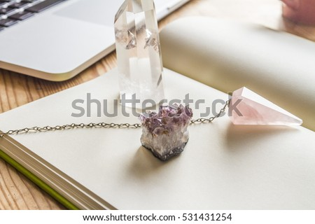 White notebook on wooden table with crystals and laptop #531431254