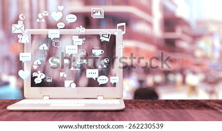 White notebook with social media related icons on a table and blurred city street in the background. Social media concept with vintage effect and space for text.