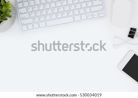 white office desk table with a...