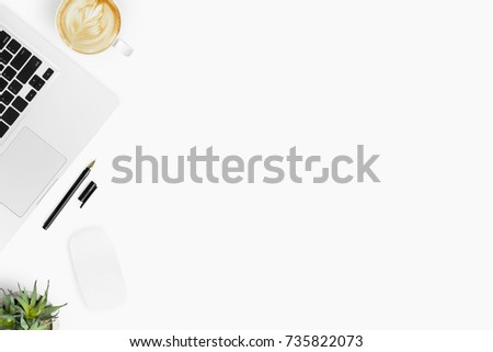 Shutterstock White office desk table with computer gadgets, cup of coffee and other office supplies. Top view with copy space, flat lay.