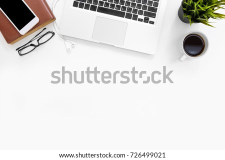 White office desk table with laptop, and office supplies. Top view with copy space, flat lay.