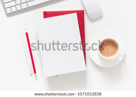 white office desk with notebook, diary of red and white color, office supplies, cup of coffee. Flat lay, top view, copy space