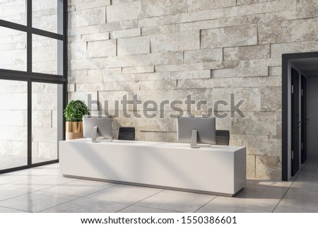 White office lobby interior with reception desk, computers, shadows, city view, daylight and empty copyspace on stone wall. Mock up, 3D Rendering
