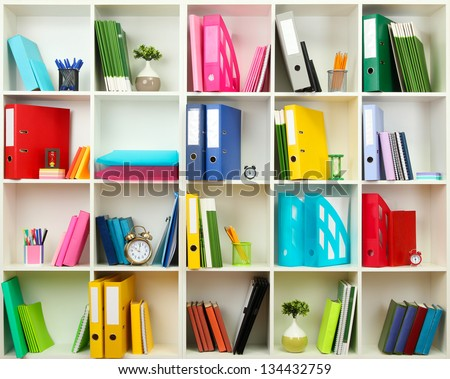 White office shelves with different stationery, close up stock photo