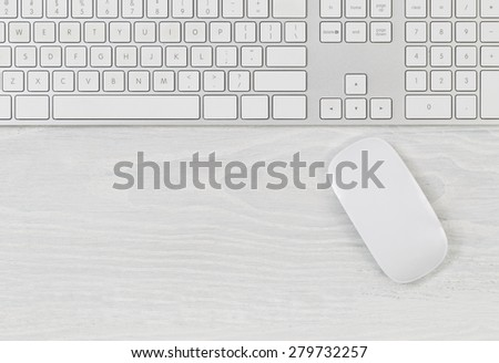White office table with computer keyboard and mouse. Top view with plenty of copy space.