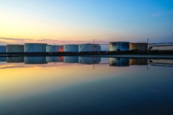 White oil tank, water reflection, beautiful evening
