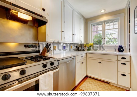 White old kitchen with stainless steal appliances.
