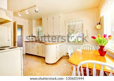 White old small kitchen interior in American house build in 1942.
