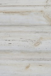 White old wooden plank wall painted with patina