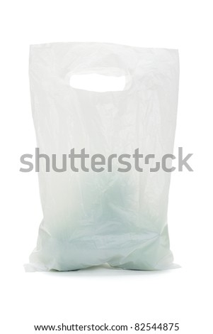 White opaque plastic bag containing green apples on isolated background