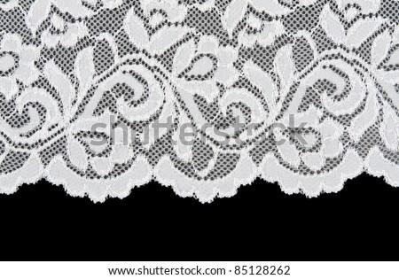 White openwork lace isolated on black background