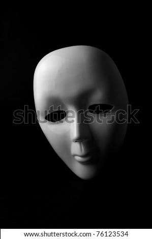 White opera mask on black background