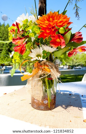 White orange and green wedding flower arrangements with for Orange centerpieces for tables