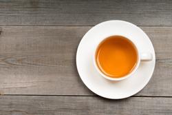 white organic green tea cup on rustic table