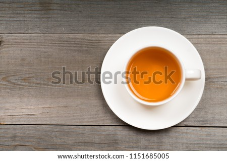 white organic green tea cup on rustic table #1151685005