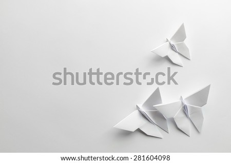 White origami butterflies on white background #281604098