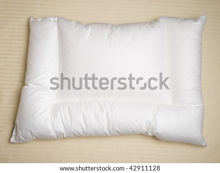white orthopedic pillow