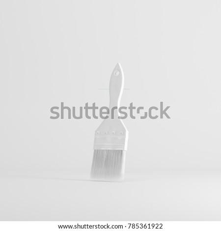 white paint brush floating on white background. minimal concept idea. monochrome.
