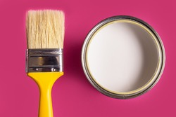 White Paint Can with Brush Top View On pink Background.