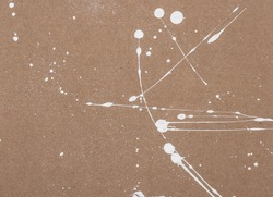 White Paint Splatters On Recycled Paper.