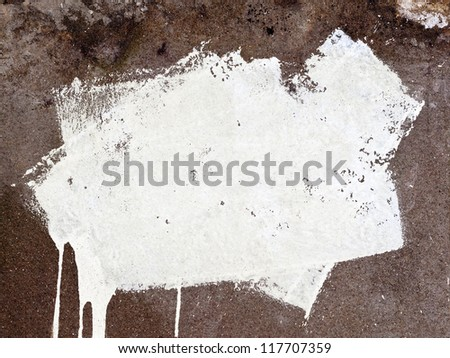 White paint strokes on grunge concrete wall