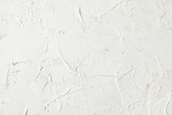 White painted texture with brush and palette knife strokes for interesting and modern backgrounds. Suitable for web design and wallpapers.