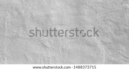 White painted wall. Texture of a white surface with roughness and roughness.
