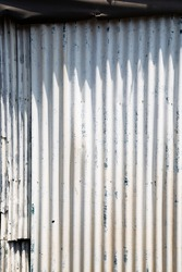 White painted wave metal sheet wall texture background