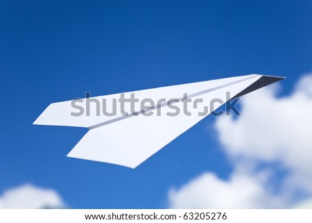 White Paper Airplane and blue sky