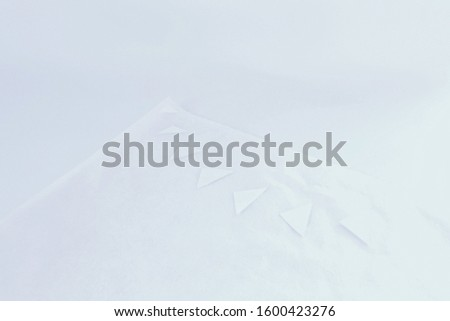 white paper and white cloth on white background.