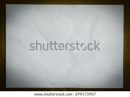 white paper background, creased paper texture.
