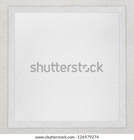 white paper background in white canvas frame or textile texture