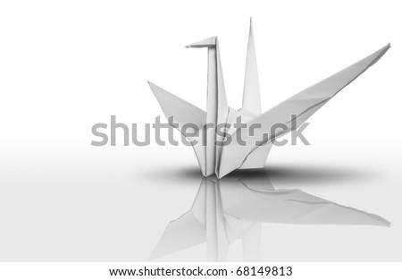 White paper bird on reflect floor