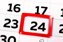 White paper calendar sheet with the black number twenty four marked in a red rectangle frame. Feast day or icon of holiday. Close-up of today. Schedule of events and agenda. Business time management.