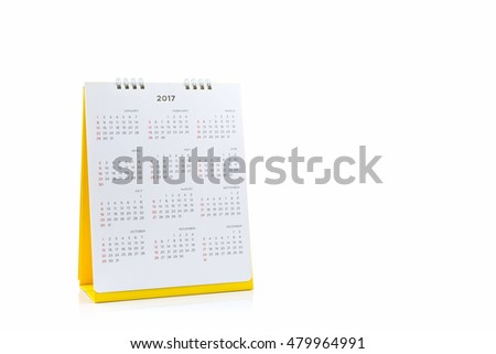 White paper desk spiral calendar 2017 on white background.