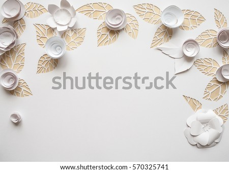 White paper flowers on white background. Cut from paper. Place for your text.