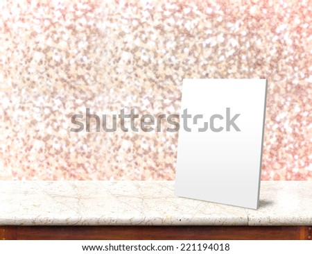 White paper frame at marble Table with bokeh pink sparkling background,Empty room for display your product