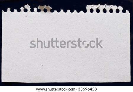 white paper from notebook isolated on black background