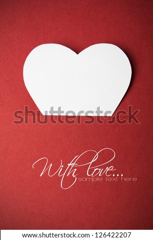 White paper heart in red paper pocket with copy space