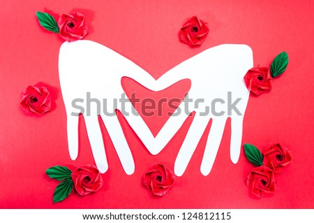 White Paper Heart. On a red background.