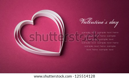 White paper heart on the purple with copy space