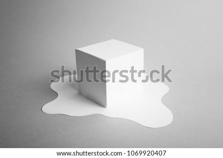 white paper ice cube melting minimal concept #1069920407