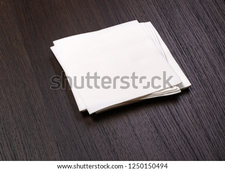 white paper napkin on old wooden table