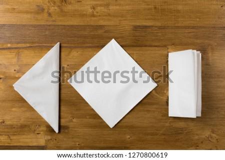 white paper napkin on wooden background
