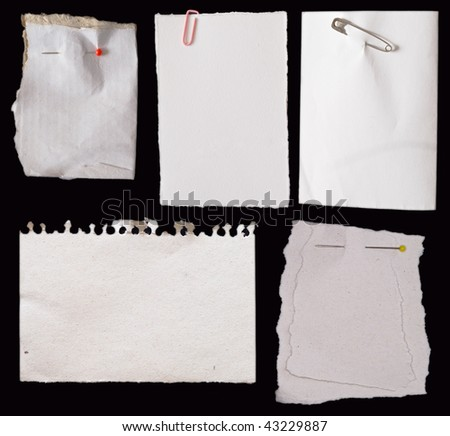 white paper notes on black background
