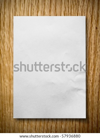 White paper on red oak background with shadow