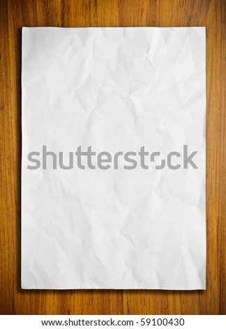 White paper on wood floor