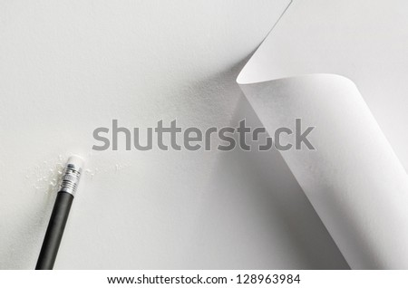 White paper, partially rolled up, with pencil and rubber