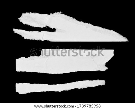White paper pieces isolated on black background. Ripped wrinkled glued paper poster texture