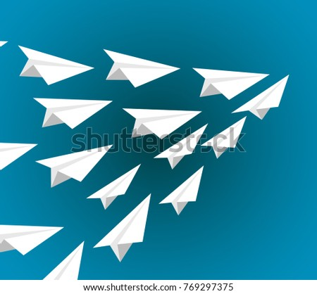 white paper planes flying on a pattern formation isolated over a blue background